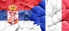 Serbia flag with France flag on a grunge cracked wall Stock Illustration