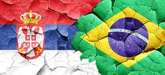 Serbia flag with Brazil flag on a grunge cracked wall Stock Illustration