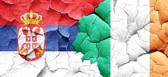Serbia flag with Ireland flag on a grunge cracked wall - stock illustration