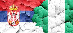 Serbia flag with Nigeria flag on a grunge cracked wall Piirros