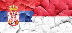 Serbia flag with Indonesia flag on a grunge cracked wall Stock Illustration