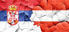 Serbia flag with Austria flag on a grunge cracked wall Stock Illustration