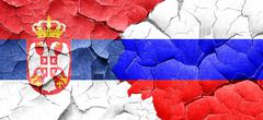 Serbia flag with Russia flag on a grunge cracked wall - stock illustration
