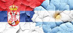 Serbia flag with Argentine flag on a grunge cracked wall Stock Illustration