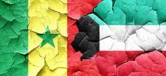 Senegal flag with Kuwait flag on a grunge cracked wall - stock illustration