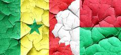 Senegal flag with Madagascar flag on a grunge cracked wall - stock illustration