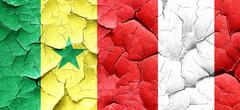 Senegal flag with Peru flag on a grunge cracked wall Stock Illustration