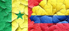 Senegal flag with Colombia flag on a grunge cracked wall Stock Illustration