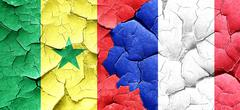 Senegal flag with France flag on a grunge cracked wall Stock Illustration