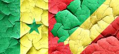 Senegal flag with congo flag on a grunge cracked wall - stock illustration