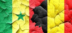 Senegal flag with Belgium flag on a grunge cracked wall Stock Illustration