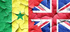 Senegal flag with Great Britain flag on a grunge cracked wall - stock illustration