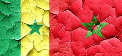 Senegal flag with Morocco flag on a grunge cracked wall Stock Illustration