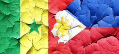 Senegal flag with Philippines flag on a grunge cracked wall - stock illustration