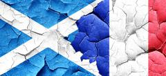 Scotland flag with France flag on a grunge cracked wall Stock Illustration