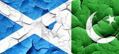 Scotland flag with Pakistan flag on a grunge cracked wall Stock Illustration
