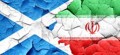 scotland flag with Iran flag on a grunge cracked wall - stock illustration