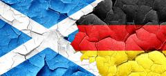 Scotland flag with Germany flag on a grunge cracked wall Piirros