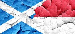 Scotland flag with Indonesia flag on a grunge cracked wall Stock Illustration