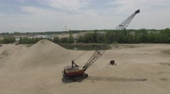 4k aerial crane in sand pit ascending view Stock Footage