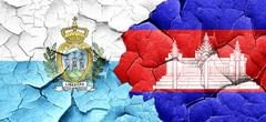 San marino flag with Cambodia flag on a grunge cracked wall Stock Illustration