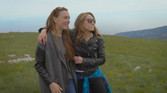 Two friends traveling together, they were in a stunningly beautiful location in Stock Footage