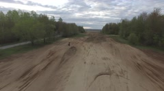 4k aerial dirt bike jumping backwards flight - stock footage