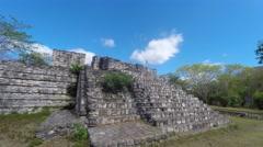 Gimbal shot of woman walking through mayan ruins at ek balam Stock Footage