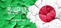 Saudi Arabia flag with Japan flag on a grunge cracked wall Stock Illustration