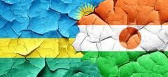 Rwanda flag with Niger flag on a grunge cracked wall Stock Illustration