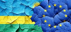 Rwanda flag with european union flag on a grunge cracked wall Stock Illustration