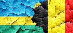 Rwanda flag with Belgium flag on a grunge cracked wall Stock Illustration
