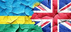 Rwanda flag with Great Britain flag on a grunge cracked wall - stock illustration