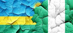 Rwanda flag with Nigeria flag on a grunge cracked wall Stock Illustration