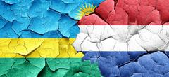 Rwanda flag with Netherlands flag on a grunge cracked wall - stock illustration