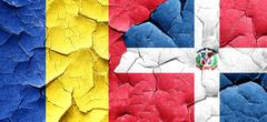 Romania flag with Dominican Republic flag on a grunge cracked wa Stock Illustration