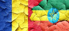 Romania flag with Ethiopia flag on a grunge cracked wall - stock illustration
