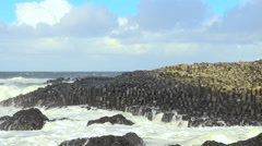 The Giant's Causeway beside the Atlantic Ocean, Northern Ireland, UK Stock Footage