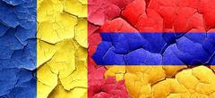 Romania flag with Armenia flag on a grunge cracked wall Stock Illustration