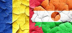 Romania flag with Niger flag on a grunge cracked wall Stock Illustration