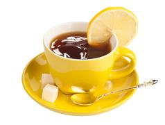Yellow teacup with sugar and lemon isolated on white Stock Photos