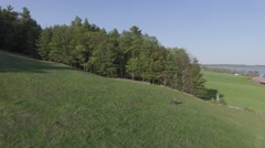 4k aerial dirtbike jump in a meadow Stock Footage