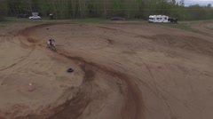 4k aerial dirtbike takes a corner Stock Footage