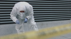 Forensic science team working on police investigation site - stock footage