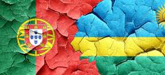 Portugal flag with rwanda flag on a grunge cracked wall Stock Illustration