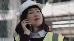Architect speaking on phone on construction site Stock Footage