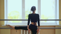 Young beautiful ballerina warming up in ballet class Stock Footage