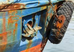 The lifted anchor onboard the old vessel Stock Photos