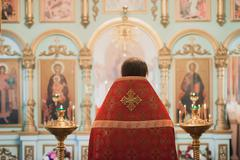 Father prayer in the Christian church, concept of religion, spirituality and Stock Photos