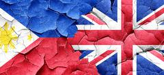 Philippines flag with Great Britain flag on a grunge cracked wal - stock illustration